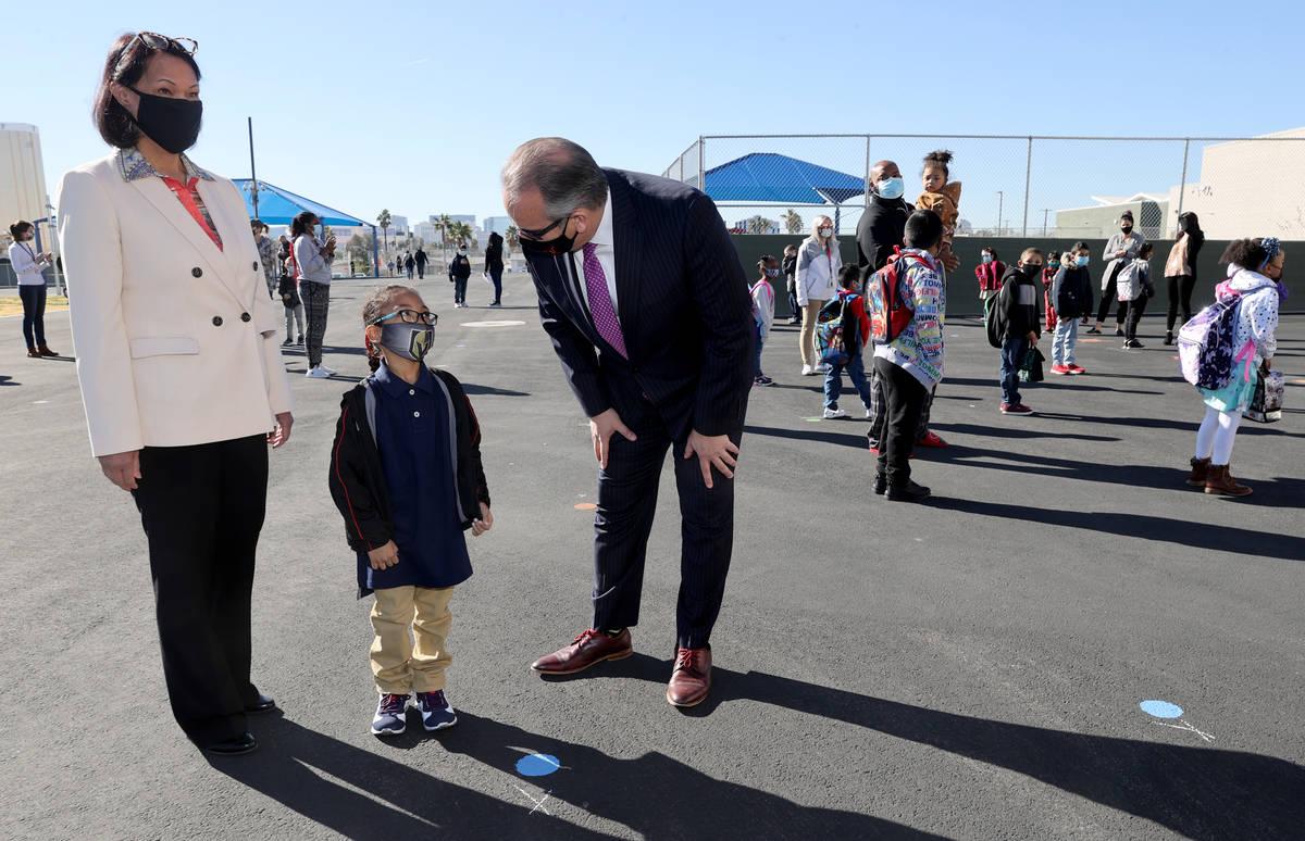 JordanMicheal (cq) Dukes, 6, greets Clark County School District Superintendent Jesus Jara and ...