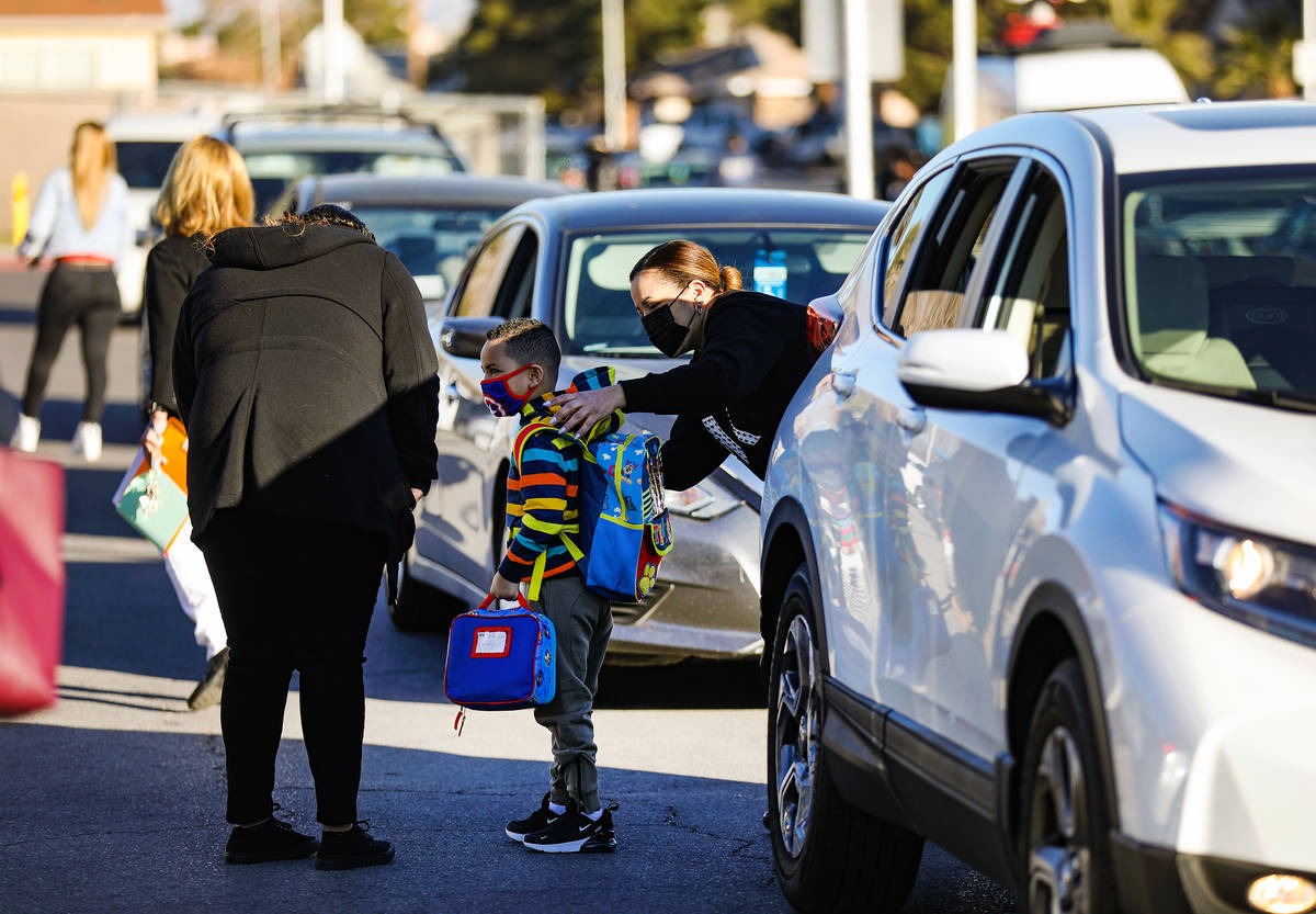 Students are dropped off at Cyril Wengert Elementary School in Las Vegas, Monday, March 1, 2021 ...