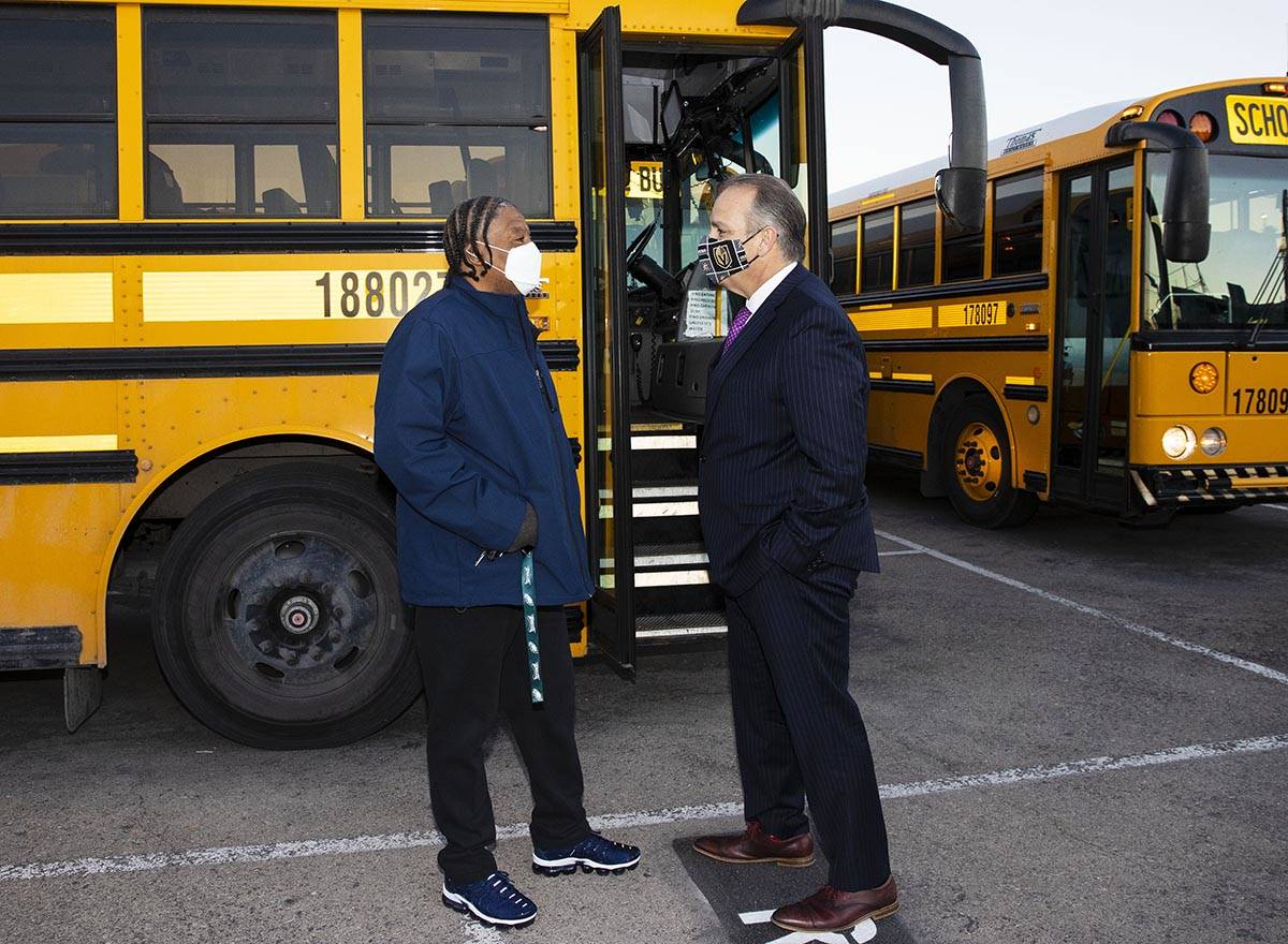 Clark County School District Superintendent Jesus Jara, right, chats with Jerry Preston, a scho ...