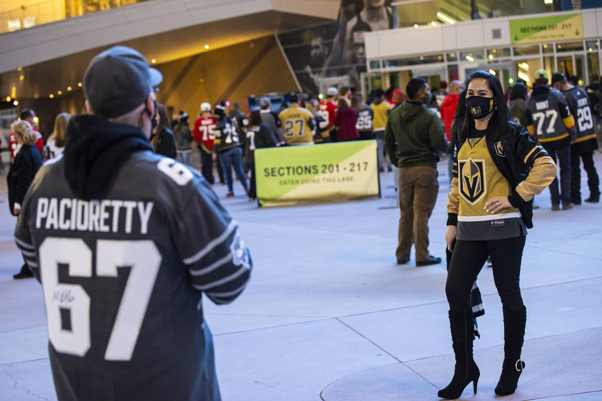 Gladys Peltzer, of Las Vegas, poses for a photo as fans arrive for the first Golden Knights gam ...