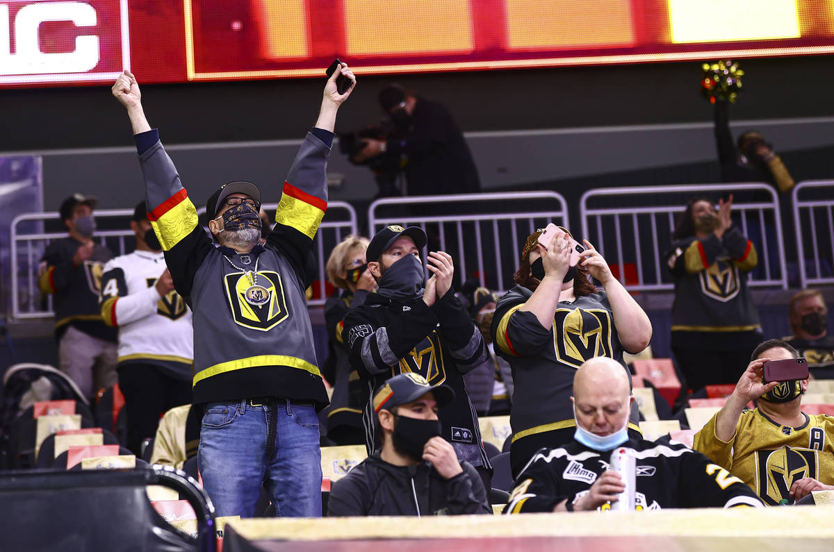 Golden Knights fans cheer as players warm up before taking on the Minnesota Wild in an NHL hock ...