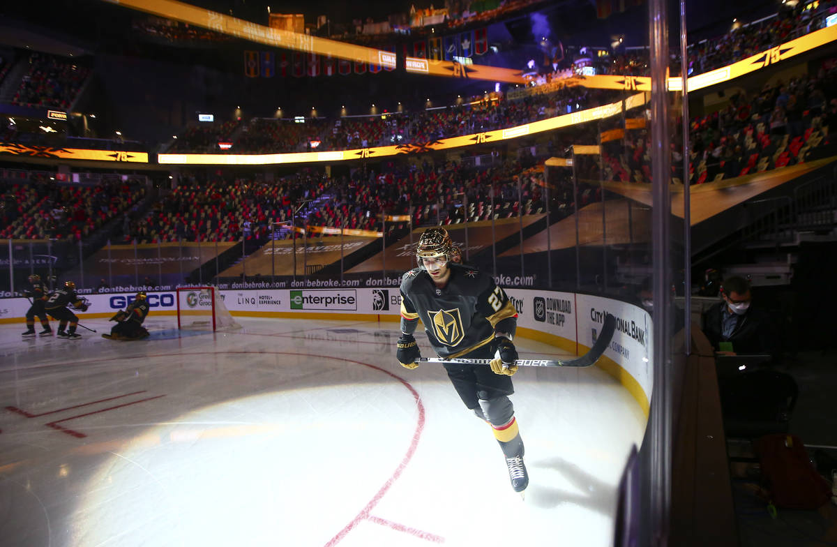 Golden Knights defenseman Shea Theodore (27) warms up before taking on the Minnesota Wild in an ...