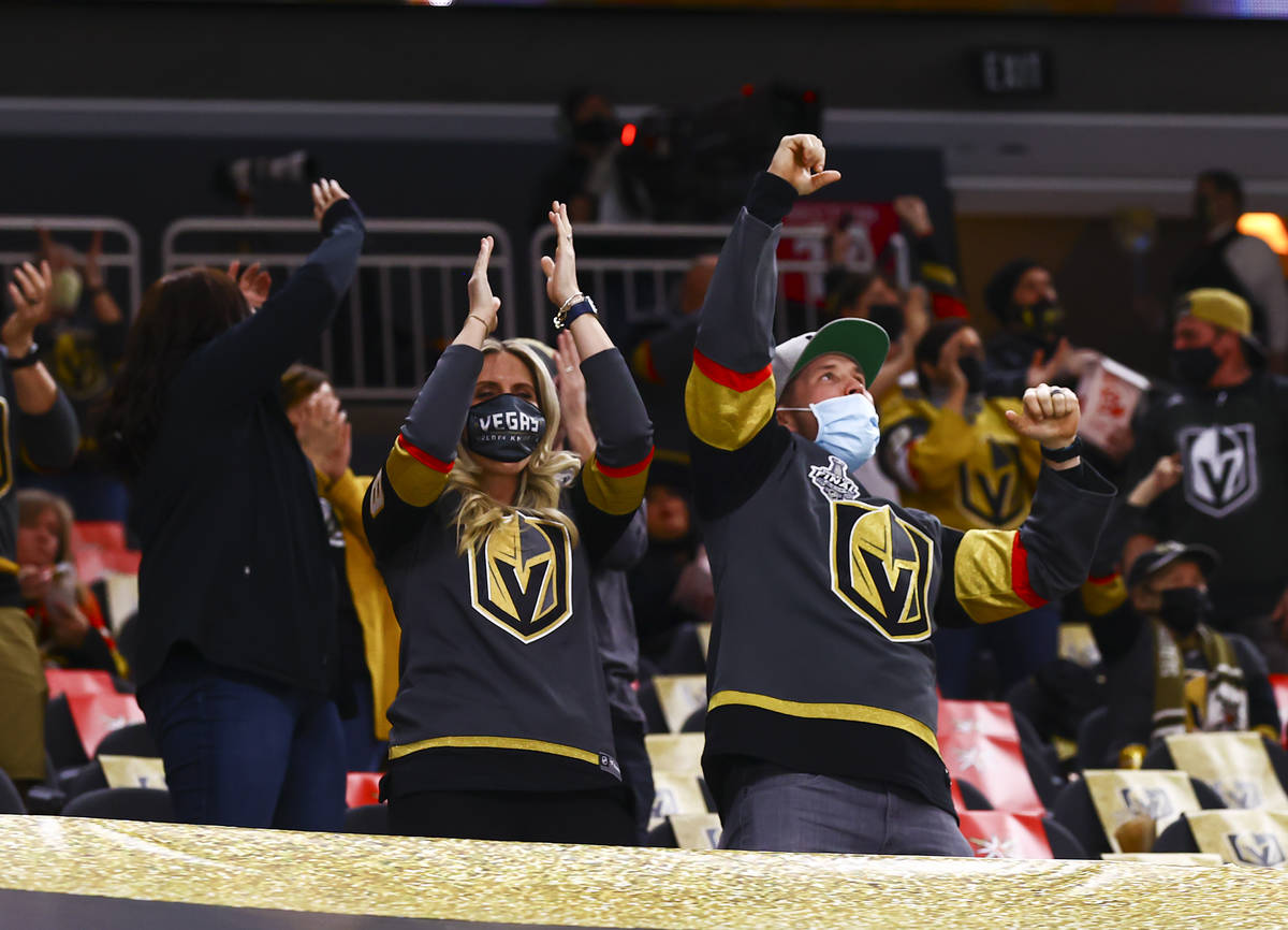 Fans celebrate a goal by Golden Knights center Cody Glass, not pictured, during the second peri ...