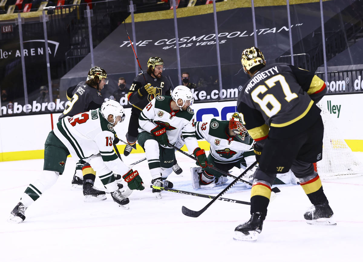 Golden Knights left wing Max Pacioretty (67) scores a goal past Minnesota Wild goaltender Cam T ...