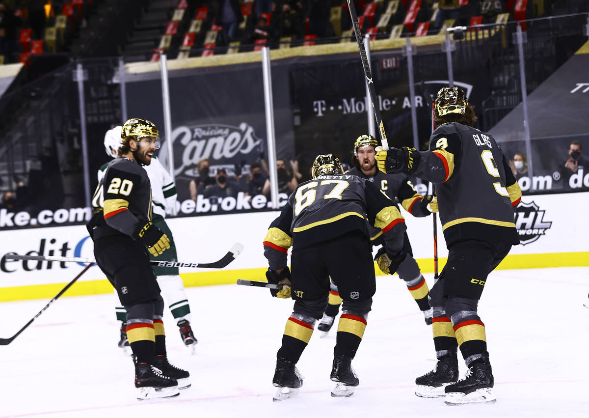 Golden Knights players celebrate a goal by Max Pacioretty during the second period of an NHL ho ...