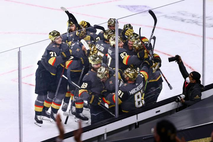 Golden Knights players celebrate their overtime win against the Minnesota Wild in an NHL hockey ...