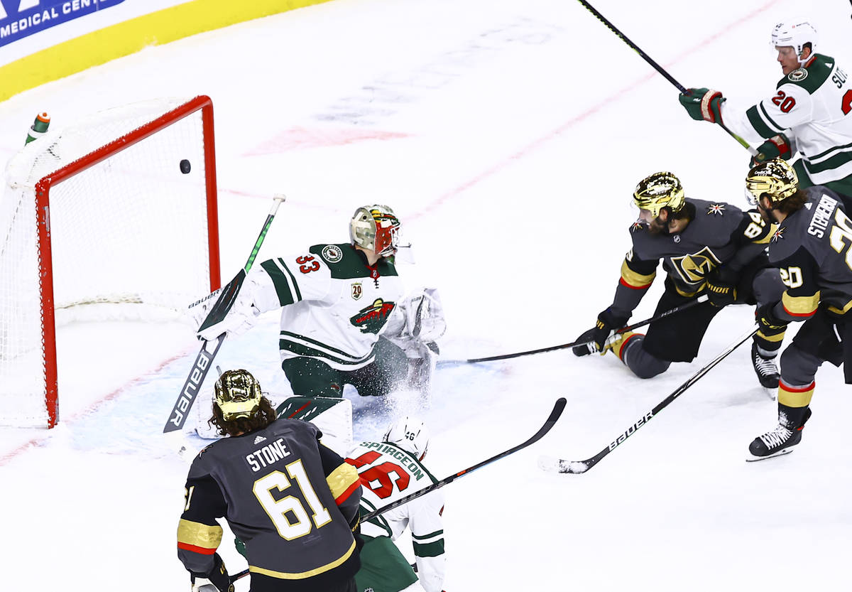 Golden Knights right wing Alex Tuch (89) scores a goal past Minnesota Wild goaltender Cam Talbo ...