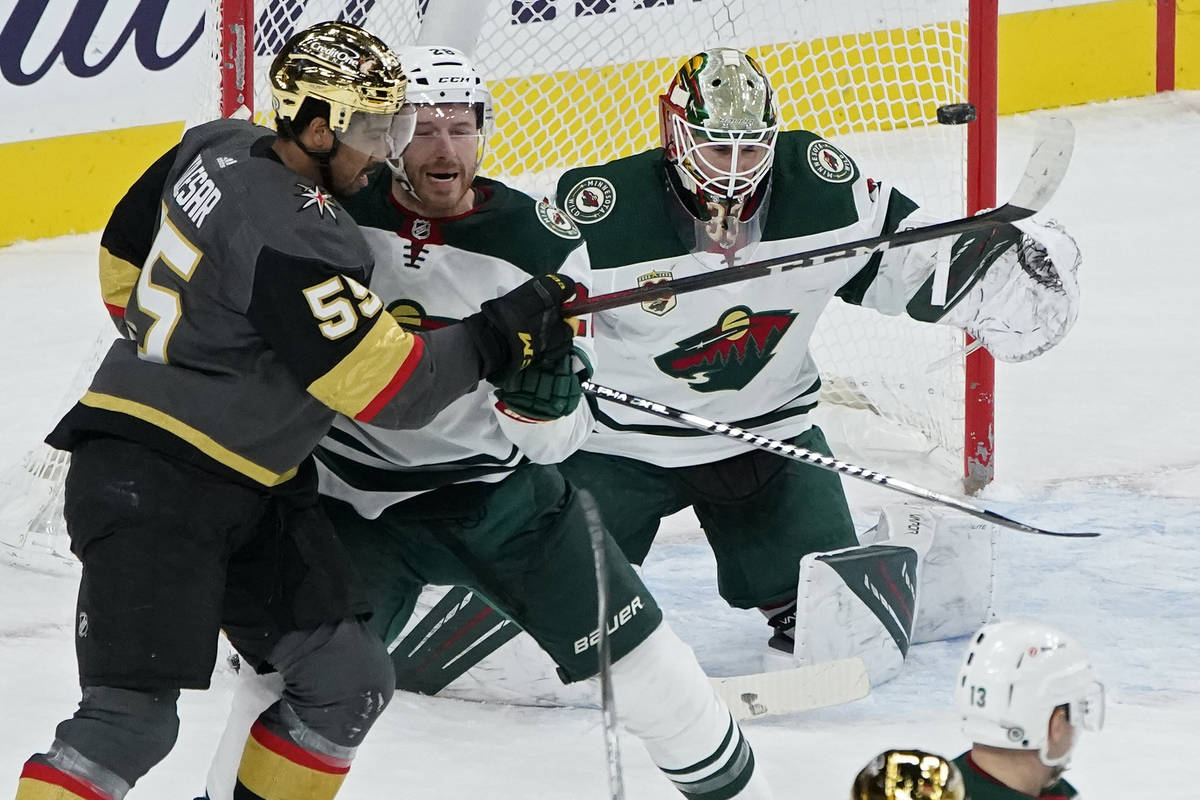 A shot by the Vegas Golden Knights hits a goal post beside Minnesota Wild goaltender Cam Talbot ...
