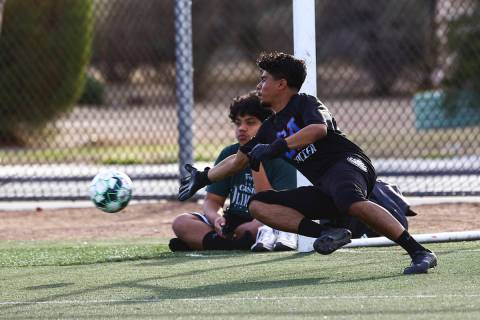 Equipo Academy goalkeeper Roberto Santana dives for the ball during soccer practice at Mike Mor ...