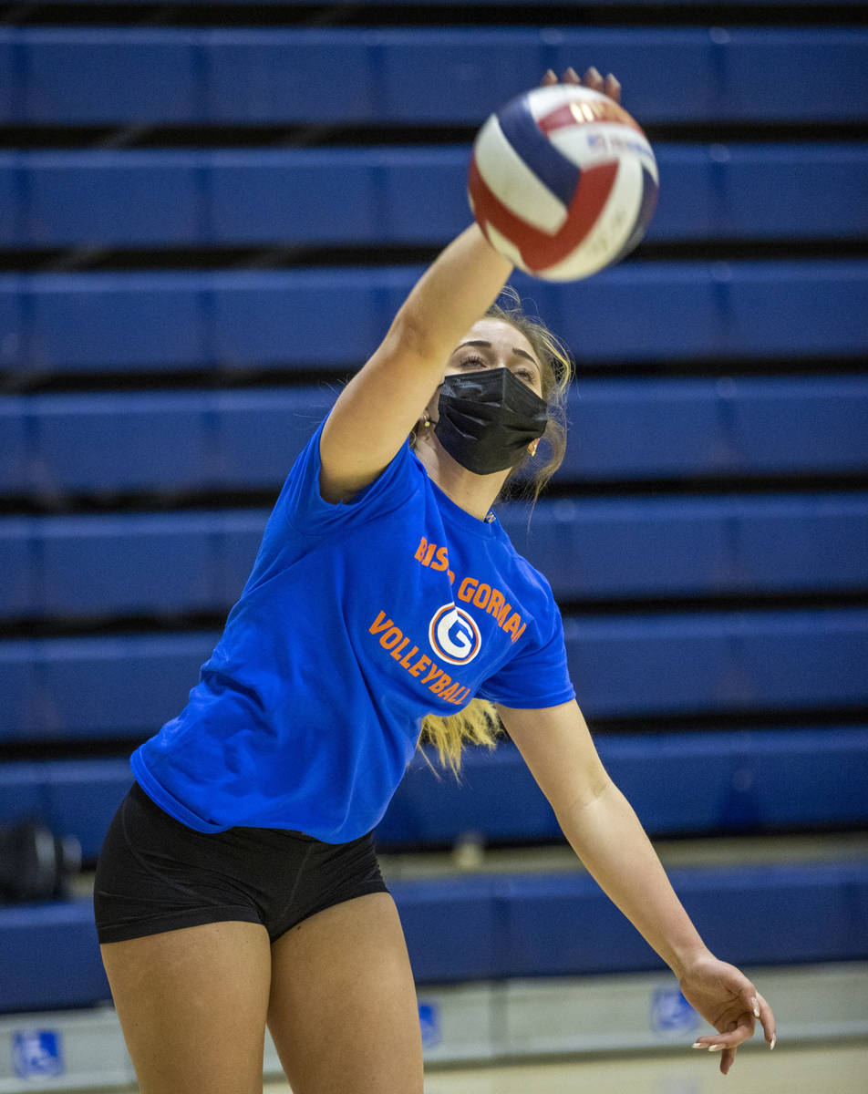 Morgan Mixer serves the ball during a varsity girls volleyball practice at Bishop Gorman High S ...
