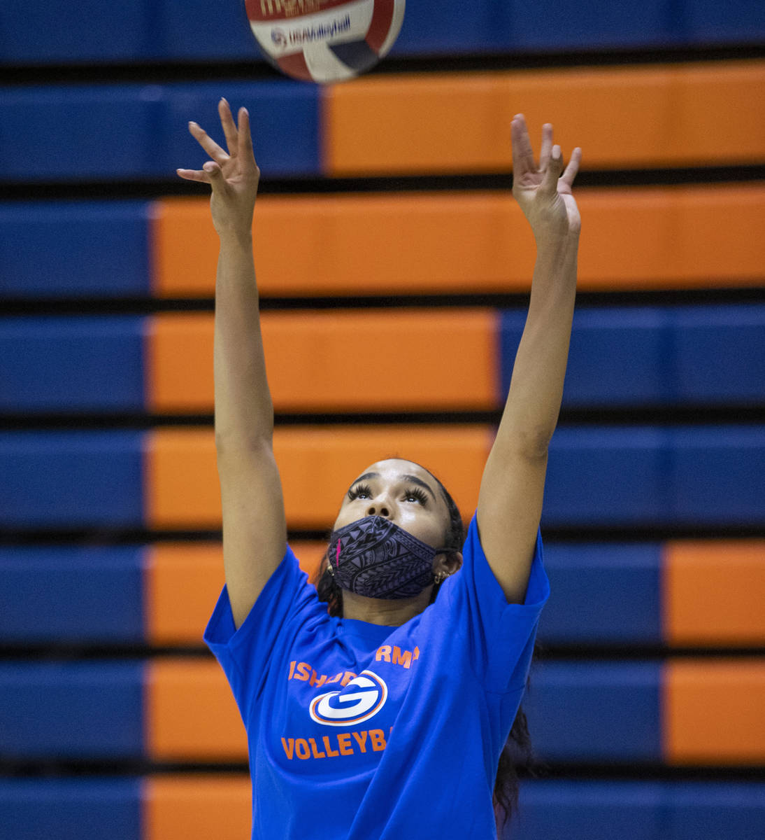Sofia Elowefo sets the ball during a varsity girls volleyball practice at Bishop Gorman High Sc ...
