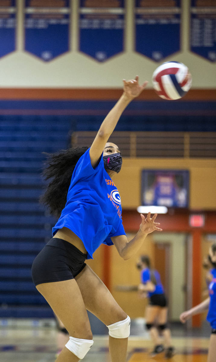 Sofia Elowefo spikes the ball during a varsity girls volleyball practice at Bishop Gorman High ...