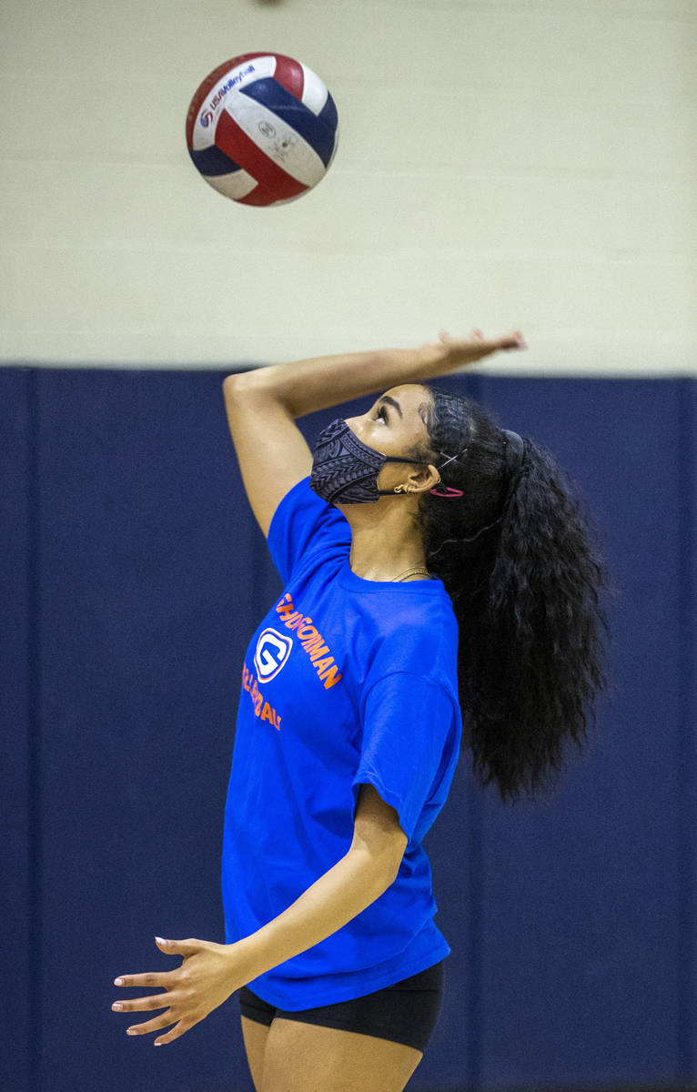 Sofia Elowefo serves the ball during a varsity girls volleyball practice at Bishop Gorman High ...