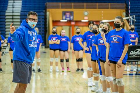 Varsity girlÕs volleyball coach Gregg Nunley instructs his players during practice at Bish ...