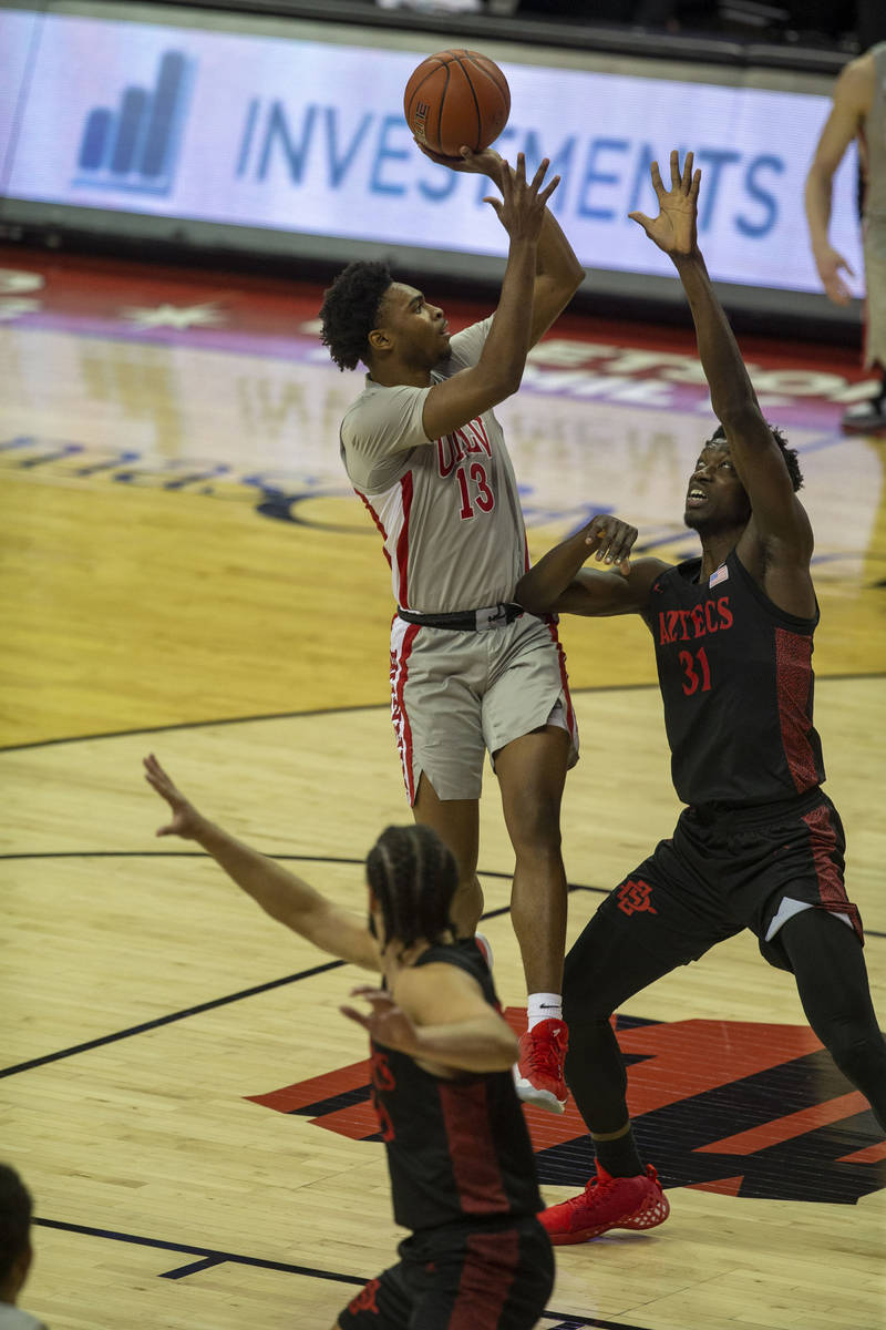 UNLV Rebels guard Bryce Hamilton (13) shoots the basketball against San Diego State Aztecs forw ...