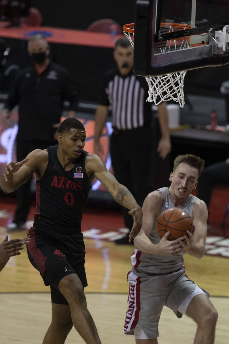 UNLV Rebels forward Moses Wood (1) rebounds as San Diego State Aztecs forward Keshad Johnson (0 ...