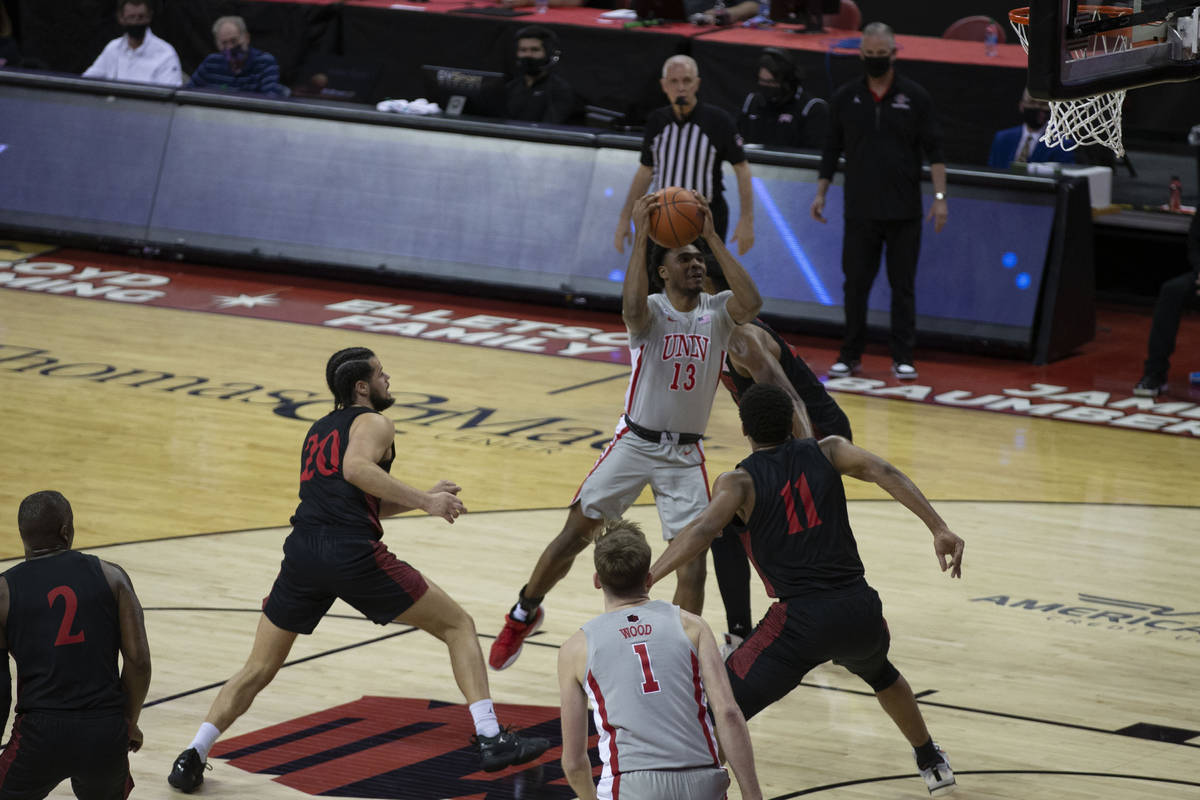UNLV Rebels guard Bryce Hamilton (13) goes up for a shot against San Diego State Aztecs forward ...