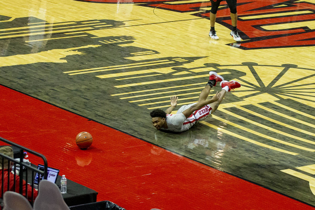 UNLV Rebels guard Bryce Hamilton (13) dives after a loose ball during the first half of an NCAA ...