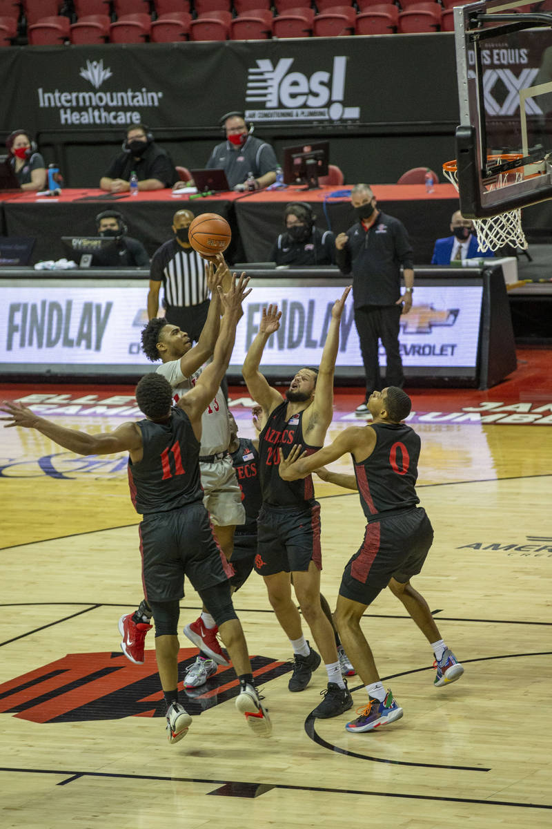 UNLV Rebels guard Bryce Hamilton (13) shoots the basketball surrounded by San Diego State Aztec ...