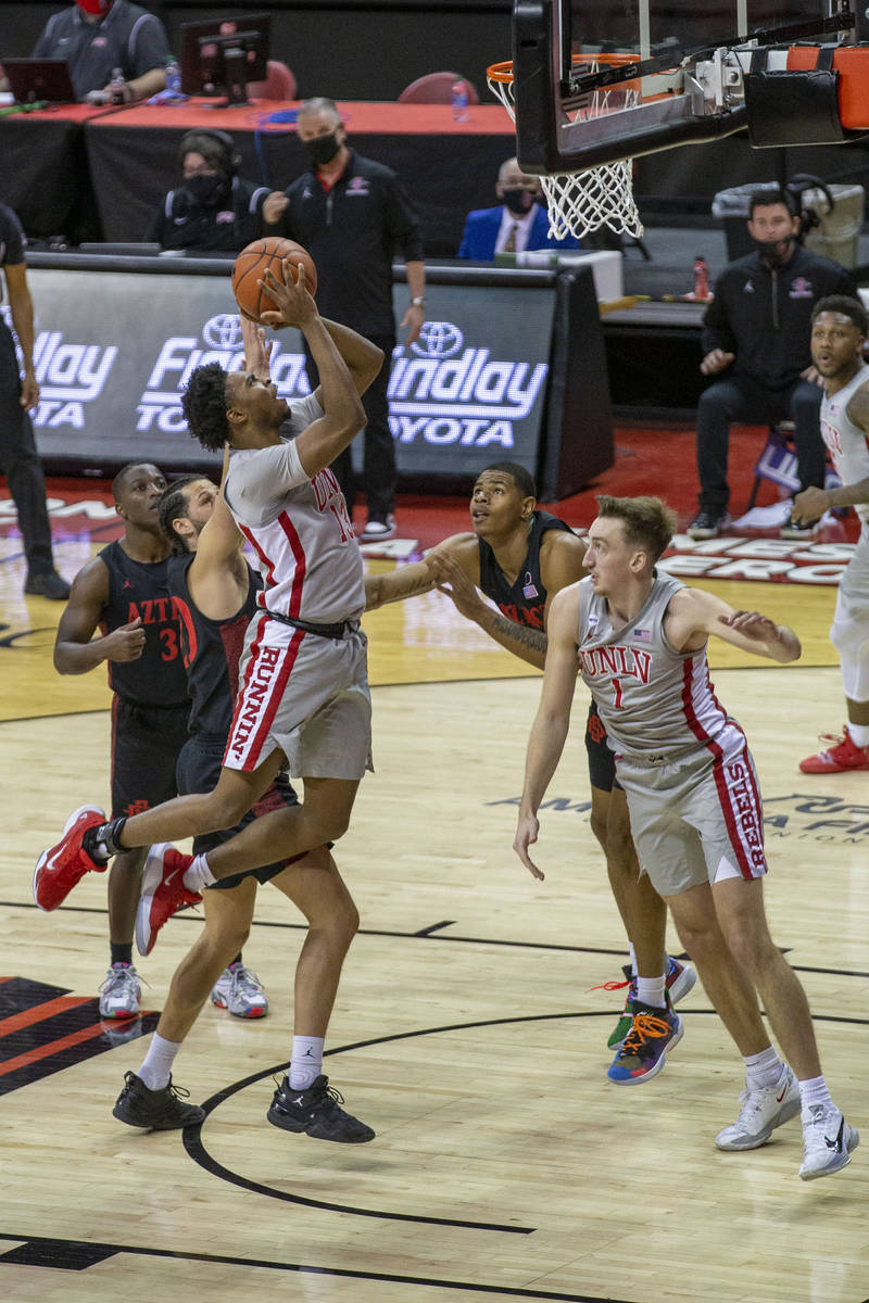 UNLV Rebels guard Bryce Hamilton (13) goes up for a jump shot during the first half of an NCAA ...