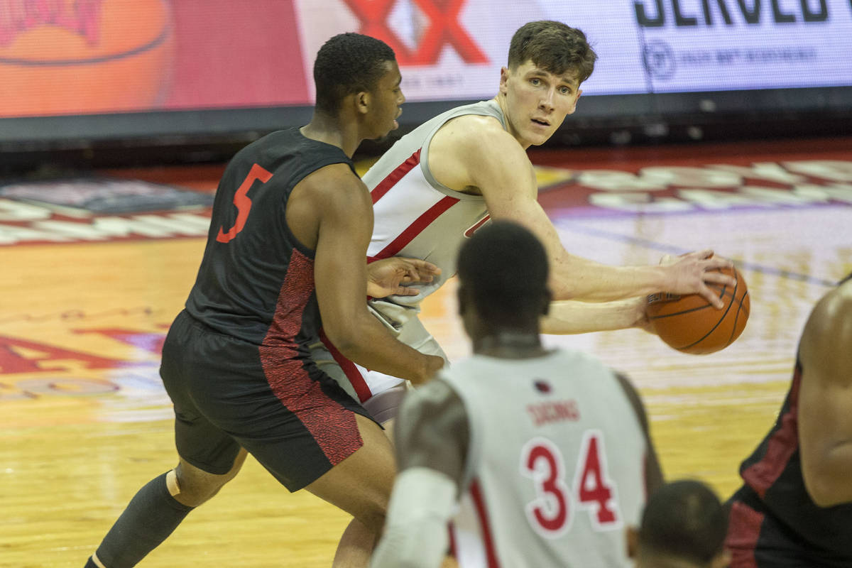 UNLV Rebels forward Moses Wood (1) looks to pass as San Diego State Aztecs guard Lamont Butler ...