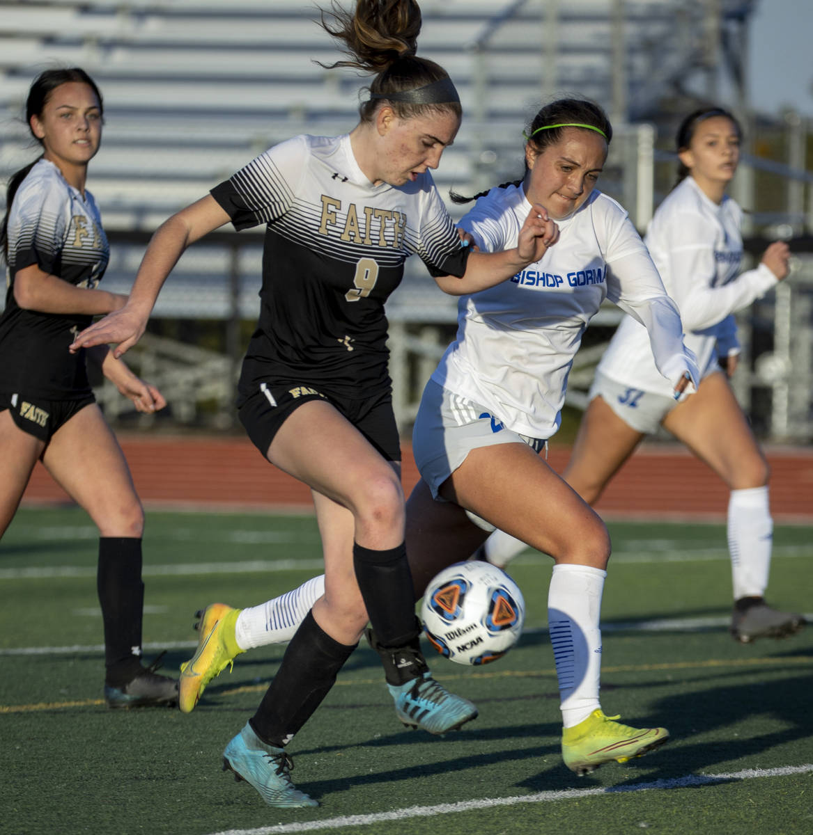 Faith Lutheran's Claire Dalbec (9) drives the ball towards the goal with Bishop Gorman's Emma C ...