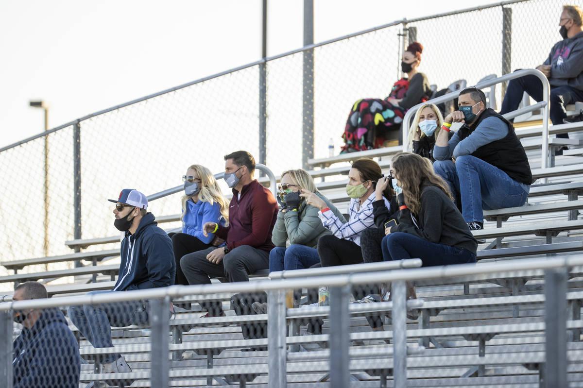 Faith Lutheran parents watch from the stands as their team battles Bishop Gorman during the fir ...