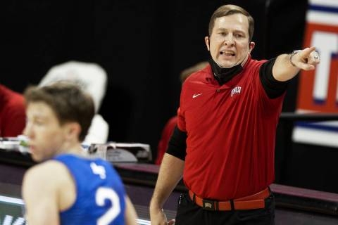 UNLV Rebels head coach T.J. Otzelberger calls a play during an game on Saturday, Feb. 6, 2021, ...