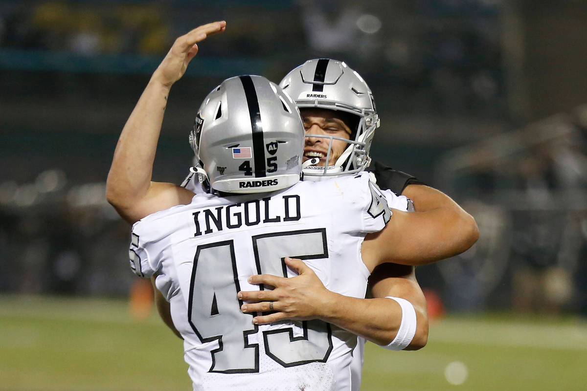 Oakland Raiders running back Alec Ingold (45) celebrates with quarterback Derek Carr after they ...