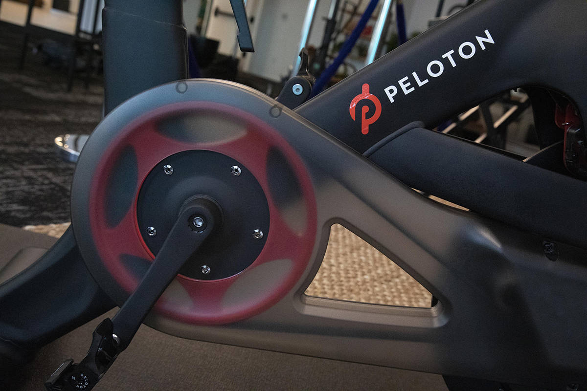 FILE-This Sept. 26, 2019, file photo shows the Peloton logo on the company's stationary bicycle ...