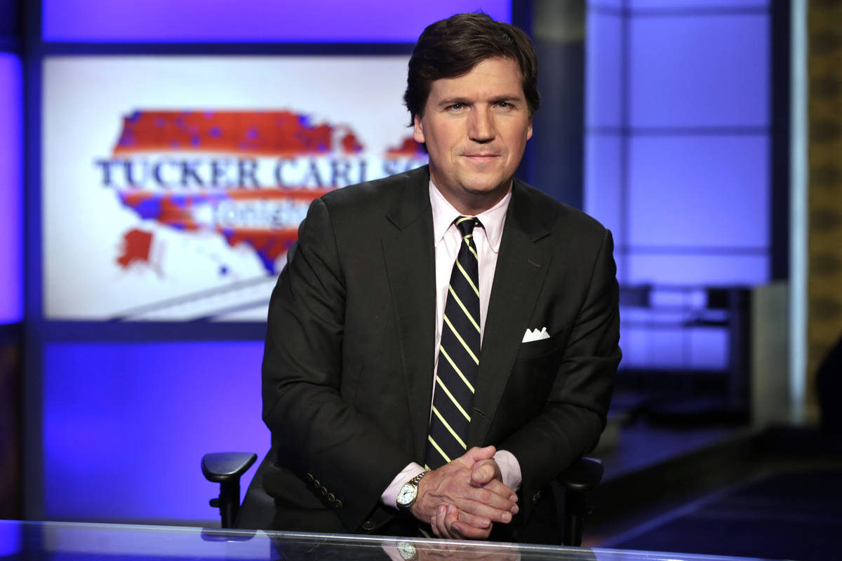"Tucker Carlson, host of ""Tucker Carlson Tonight,"" poses for photos in a Fox News Channel studio ..."