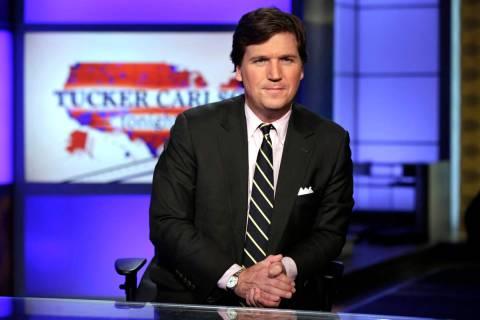 "Tucker Carlson, host of ""Tucker Carlson Tonight,"" poses for photos in a Fox News Channel studio ..."