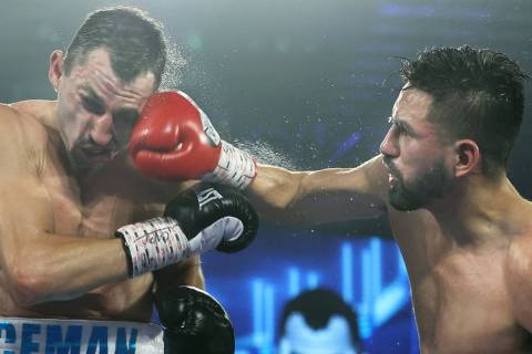 Jose Ramirez connects on a punch to Viktor Postol on Saturday night during their WBC and WBO we ...