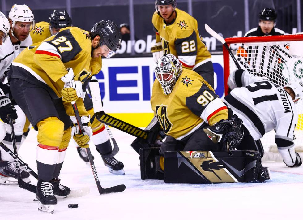 Golden Knights defenseman Shea Theodore (27) keep the puck from the Los Angeles Kings during th ...