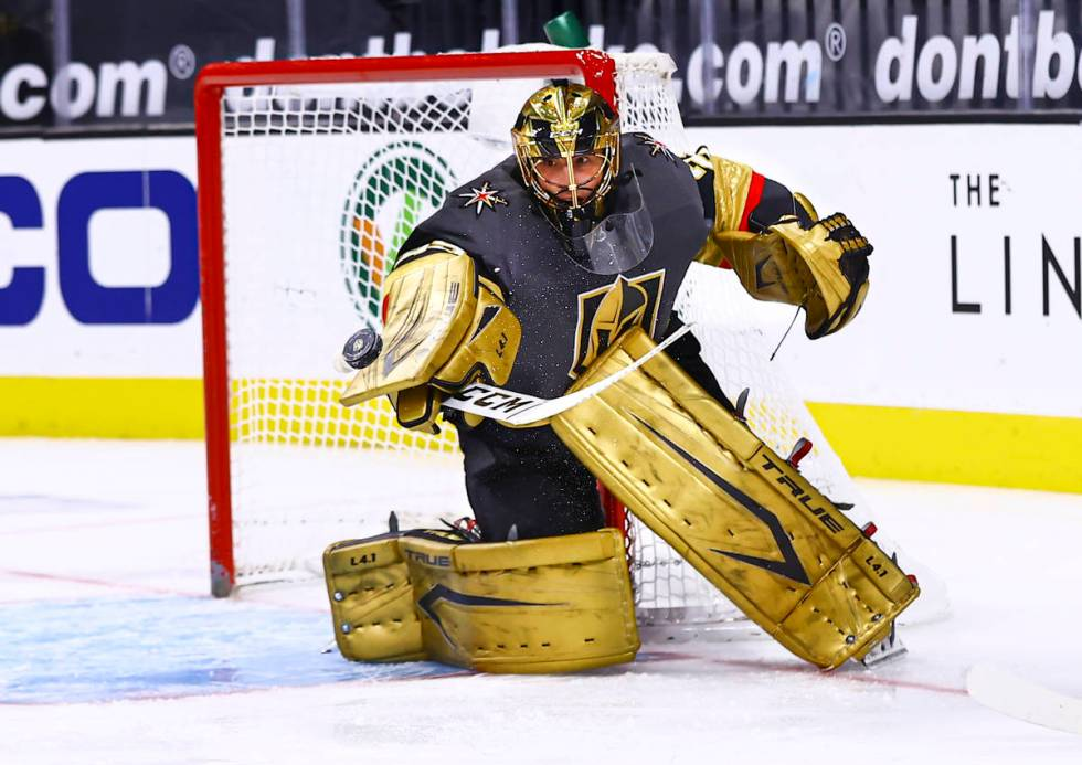 Golden Knights goaltender Marc-Andre Fleury (29) blocks the puck during the first period of an ...
