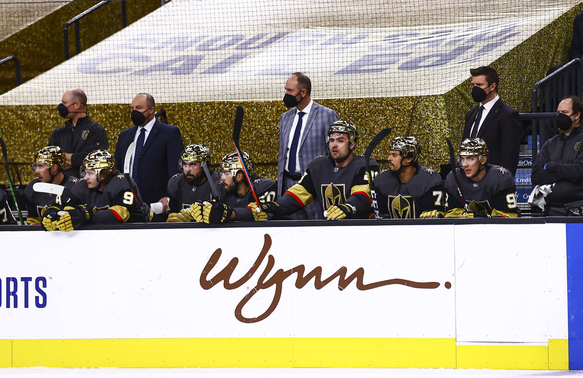 Golden Knights head coach Pete DeBoer looks on from the bench during the first period of an NHL ...