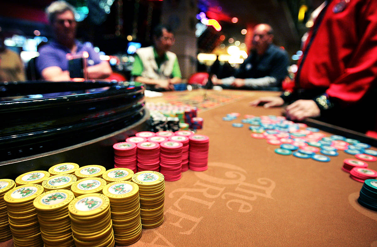 Gamblers wait for the roulette ball to settle at Boyd Gaming Corp.'s Orleans hotel-casino in La ...