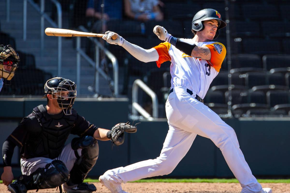 Las Vegas Aviators catcher Jonah Heim (13) misses the ball while batting in the ninth inning ve ...