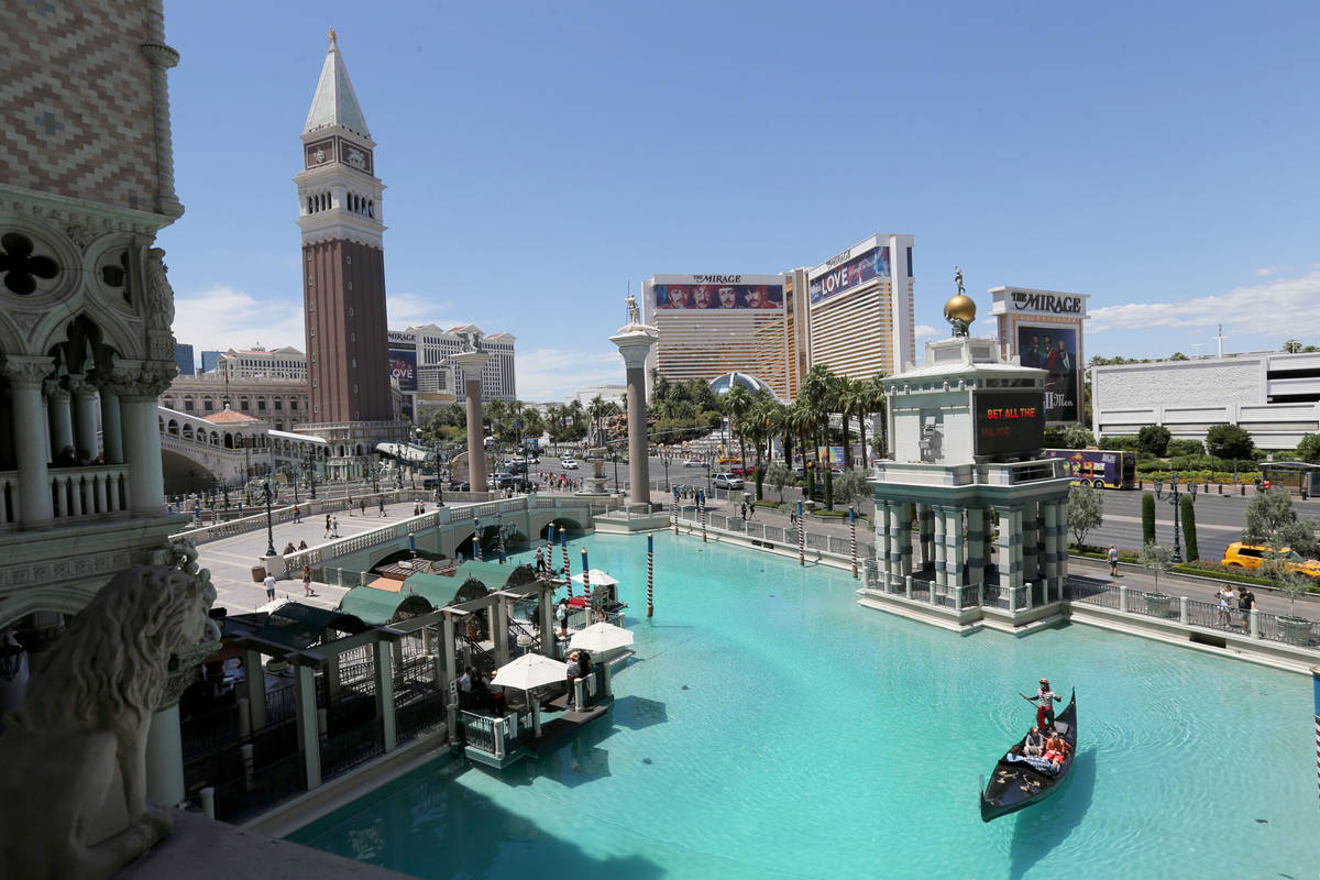Guests take a gondola ride with a singing gondolier at The Venetian on the Strip in Las Vegas T ...