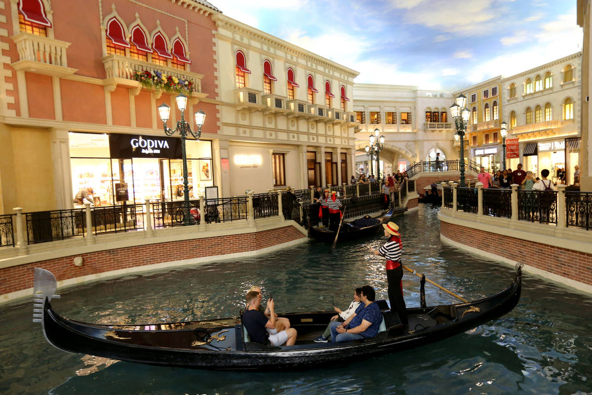 Guests take a gondola ride in the Grand Canal at The Venetian on the Strip in Las Vegas Tuesday ...