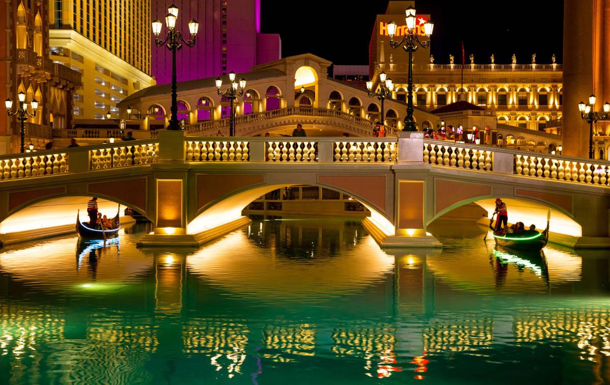 In this April 24, 2019, file photo, tourists ride gondolas at The Venetian in Las Vegas. (L.E. ...
