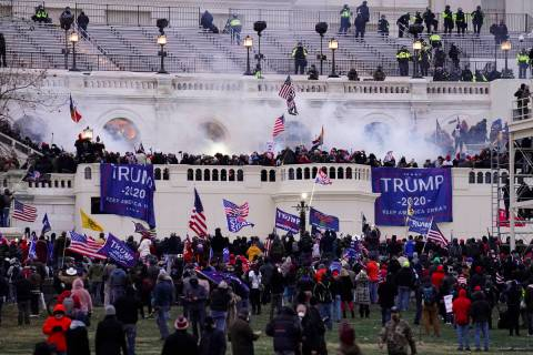 In a Wednesday, Jan. 6, 2021, file photo, rioters storm the Capitol, in Washington. At least 10 ...
