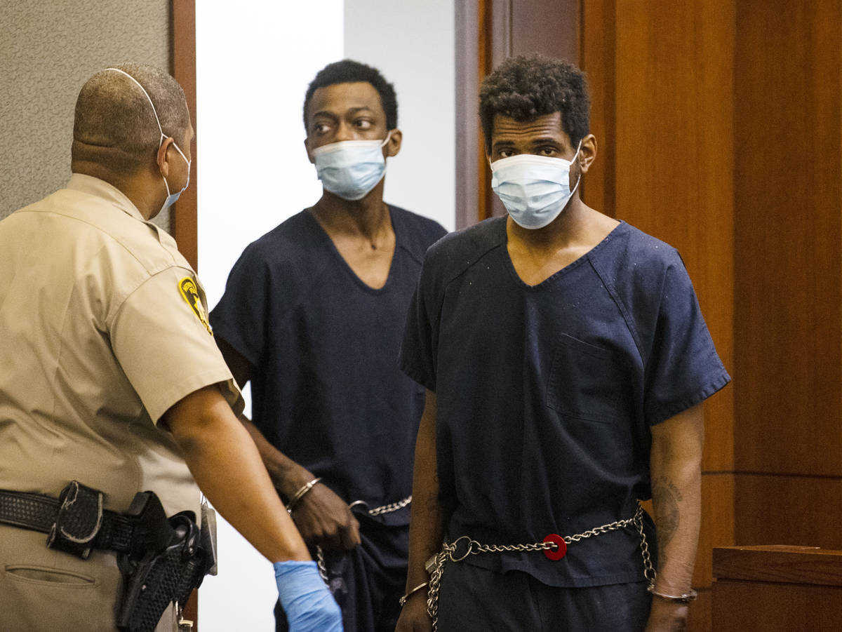 Brandon Leath, right, accused of punching and killing a man outside Bally's, is led into the co ...