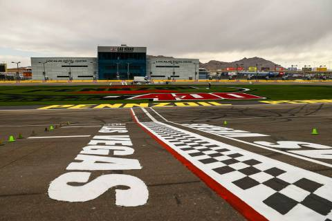 The start/finish line is seen as logos are painted on the infield grass ahead of the Pennzoil 4 ...