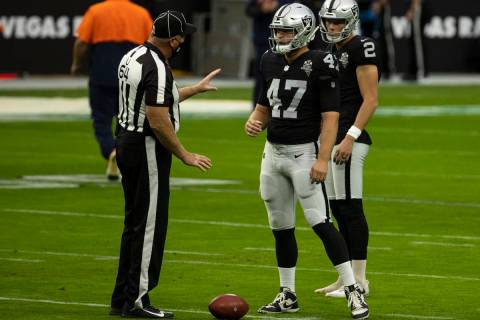 Las Vegas Raiders long snapper Trent Sieg (47) chats with umpire Dab Ferrell (64) before an NFL ...