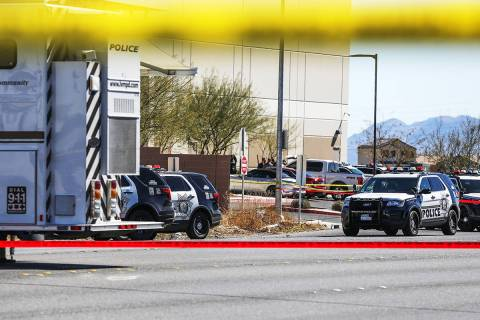 Police investigate the scene of an officer-involved shooting Monday, March 1, 2021 in northeast ...