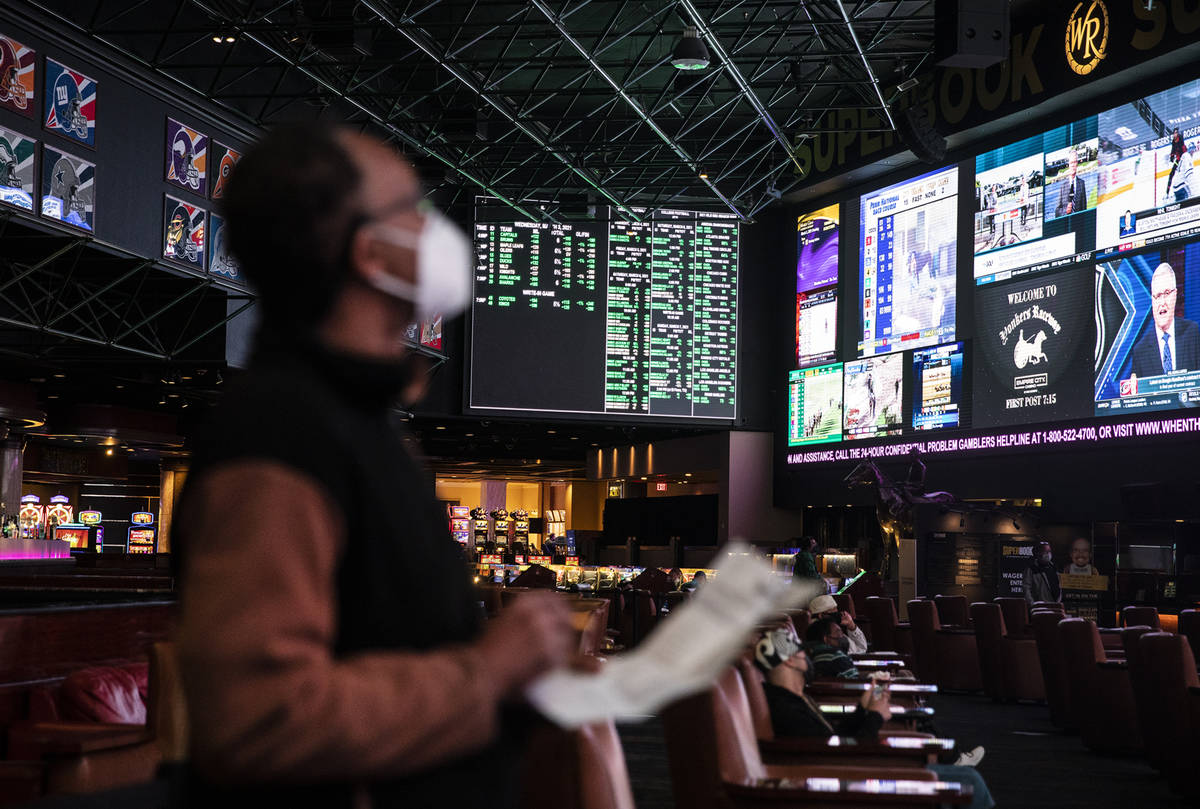 Lou Purse watches the screens at the Westgate sportsbook in Las Vegas, Wednesday, March 3, 2021 ...