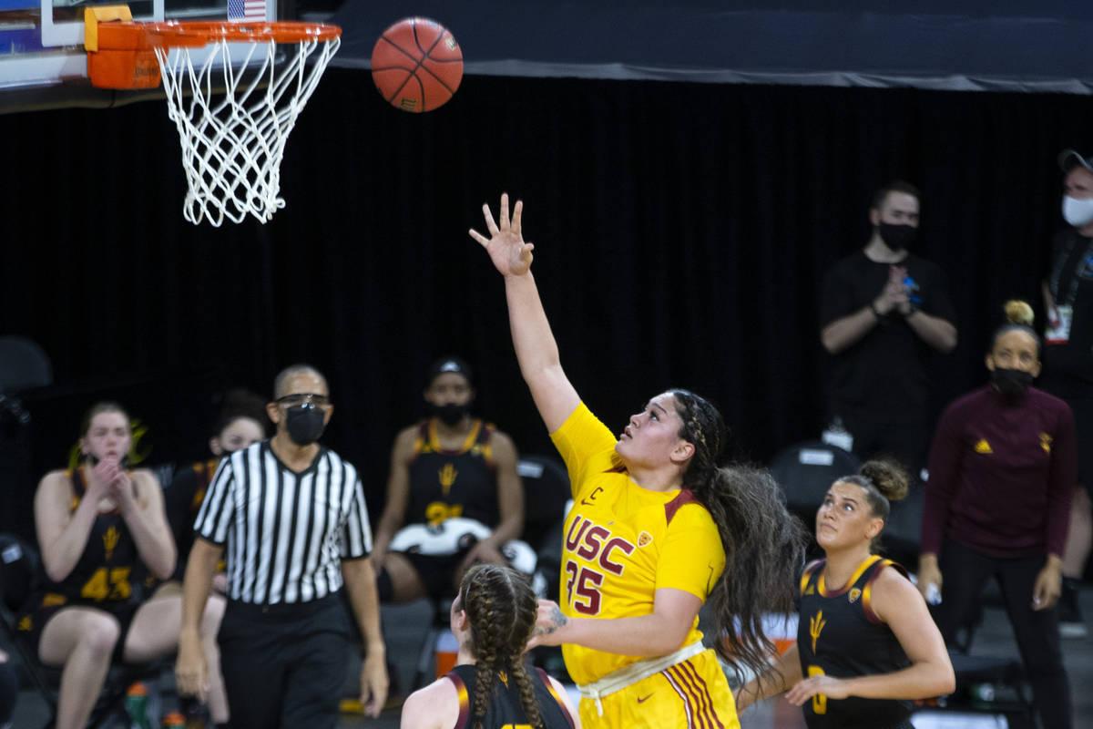 USC Trojans forward Alissa Pili (35) scores a point as Arizona State Sun Devils guard Taya Hans ...