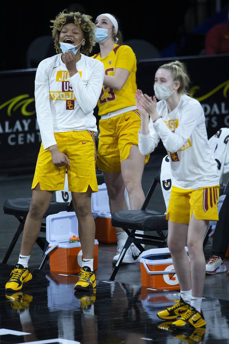 USC Trojans guard Amaya Oliver (10), guard Madison Campbell (23) and guard India Otto (2) cheer ...