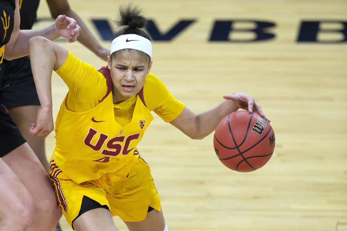 USC Trojans guard Endyia Rogers (4) dribbles around Arizona State Sun Devils guard Maggie Besse ...